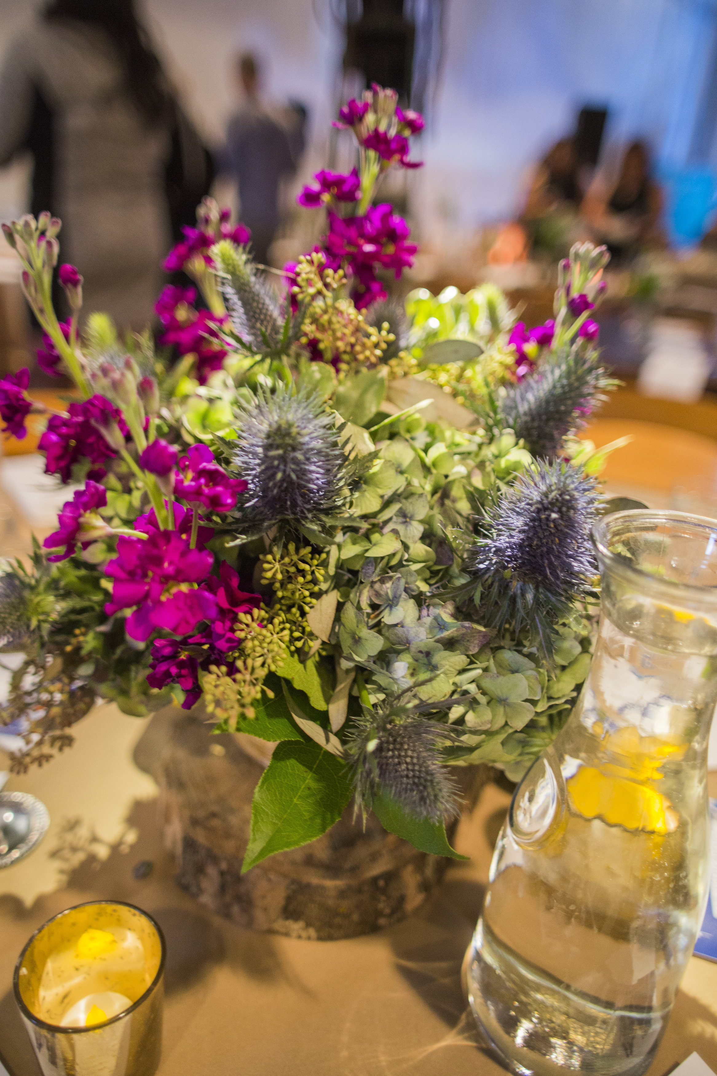 purple stock & thistle centerpiece